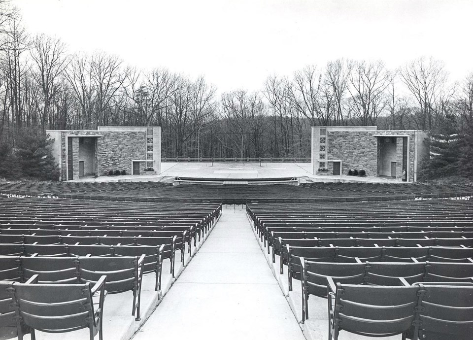 Black and white photo of a stage and seating area