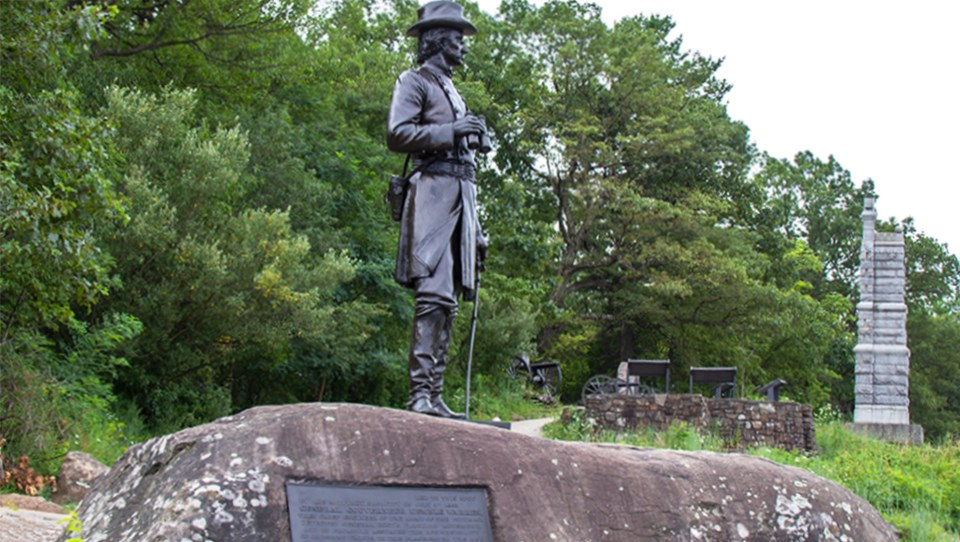 The statue to General Gouverneur Kemble Warren stands at the summit of Little Round Top.