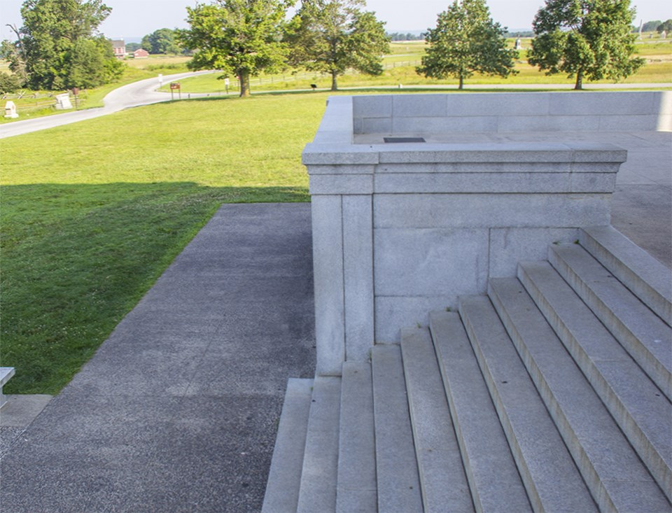 The lower steps of the Pennsylvania Memorial are visible in front of a green grass lawn.