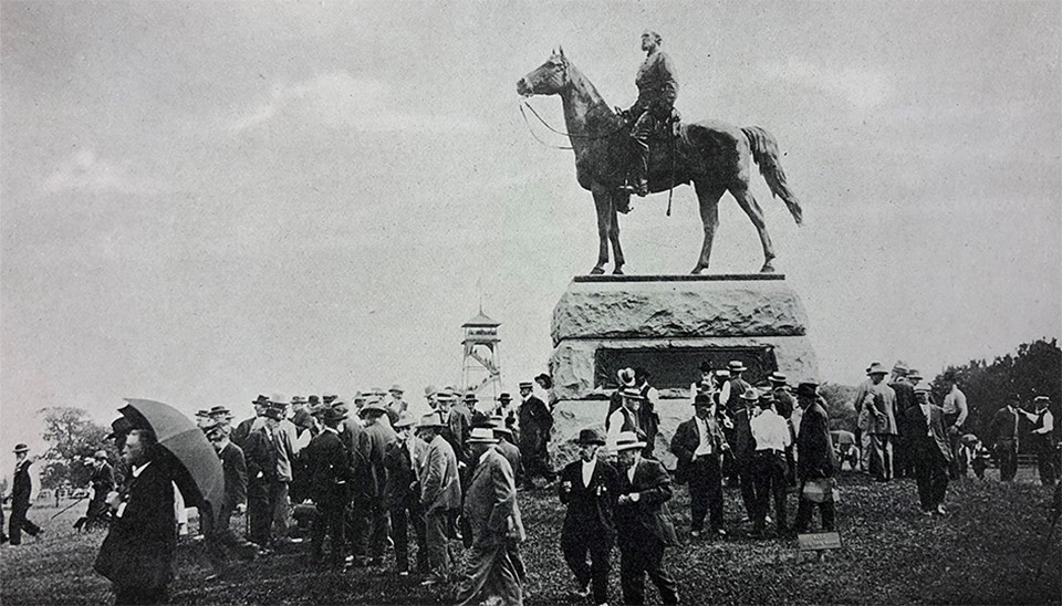 Civil War veterans gather around the large equestrian statue of General George Gordon Meade.