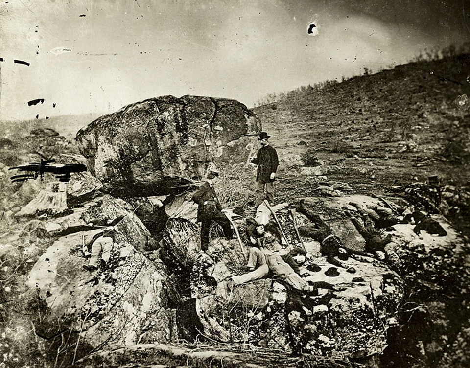 Historic view of the boulders of Devil's Den also shows the western slope of Little Round Top in the distance to the right.