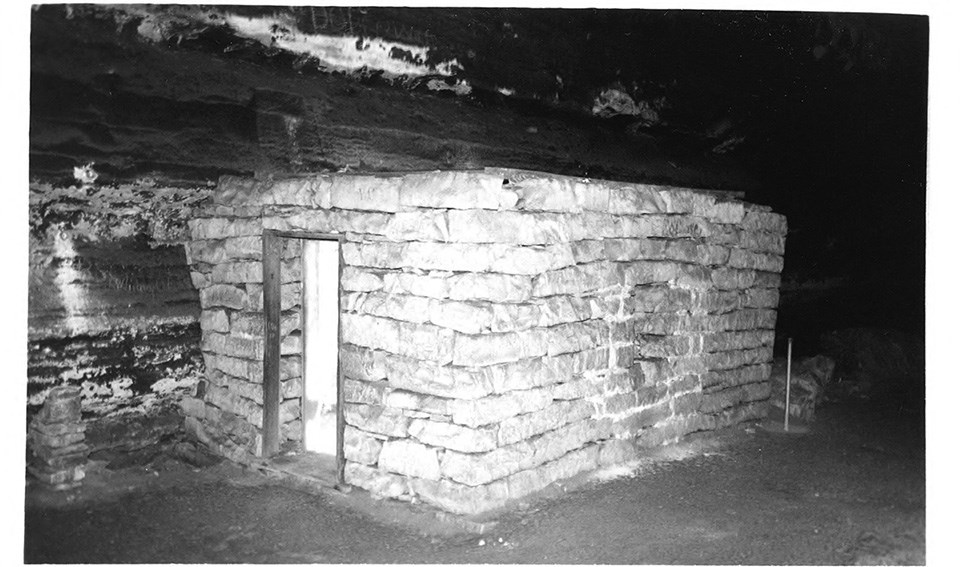 A low, square stone structure in Mammoth Cave with thick limestone walls.