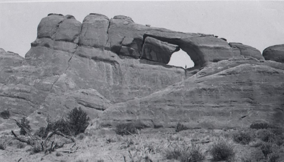 an arch with a large boulder on one side