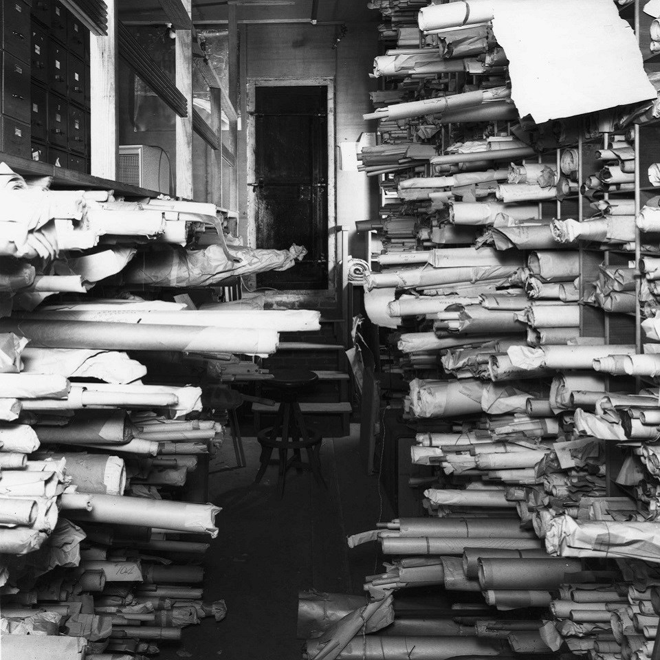 Vault with scrolls of paper in untidy stacks