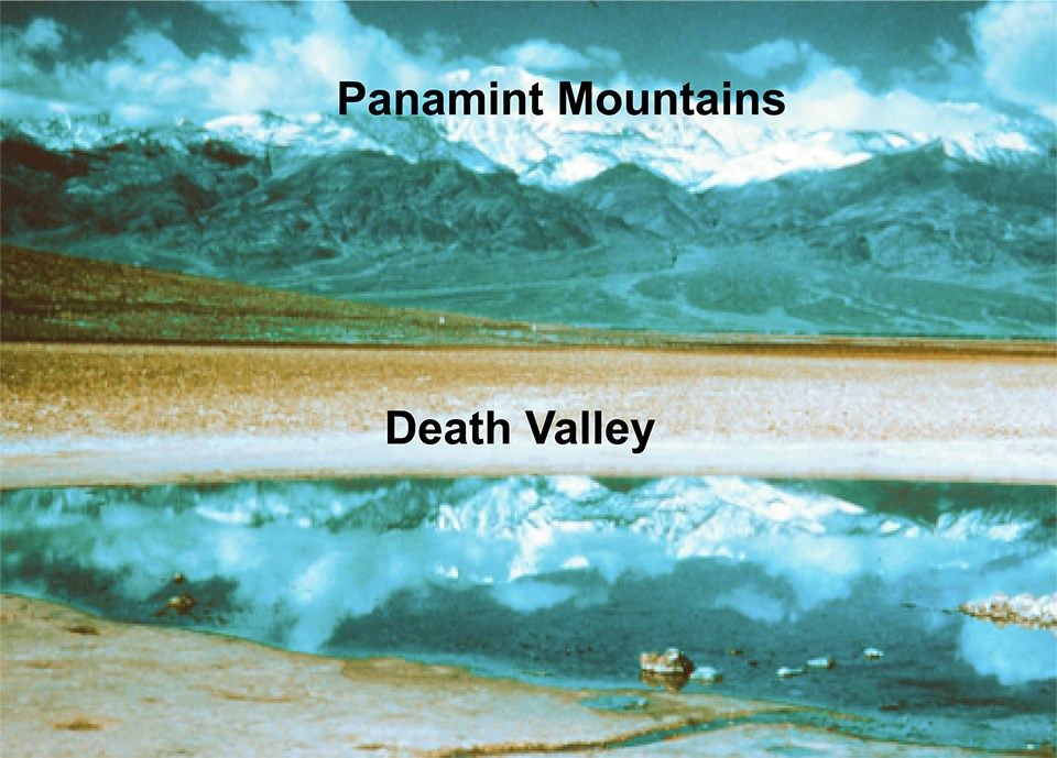 water in desert basin with mountains in background and features labeled