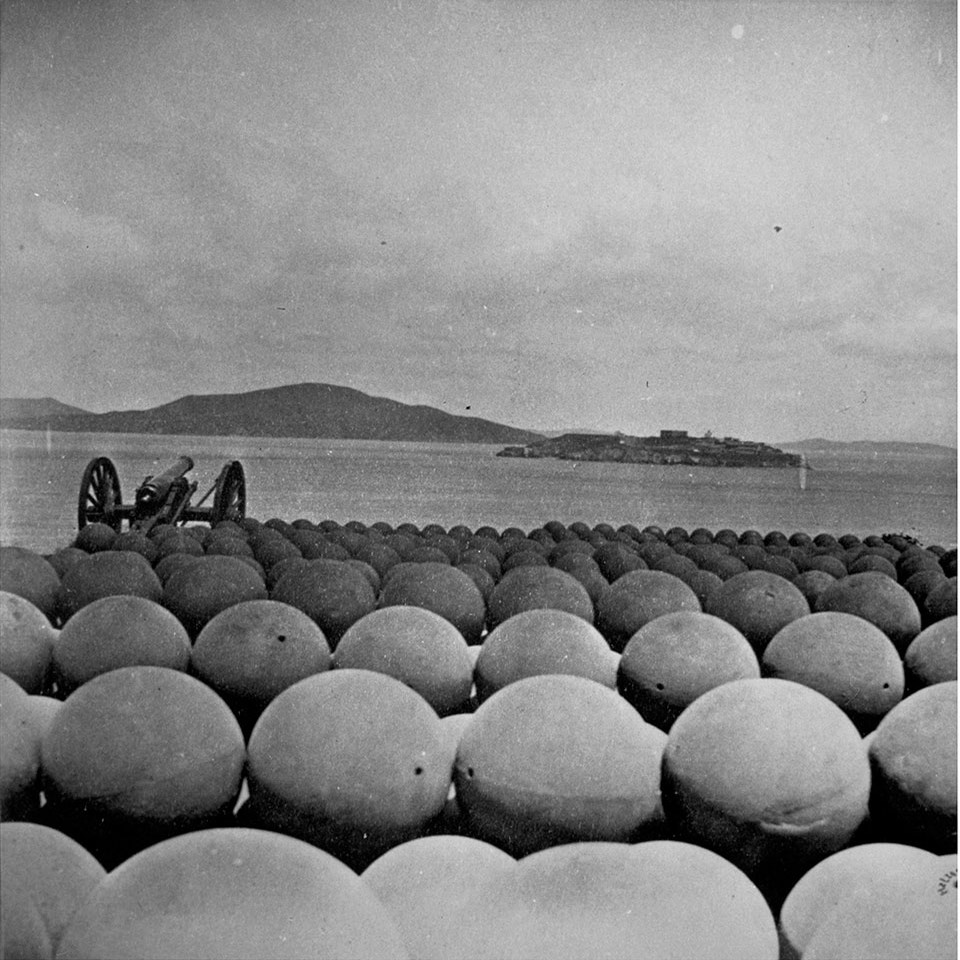 Photo of Alcatraz over Cannonballs at Fort Mason 1869