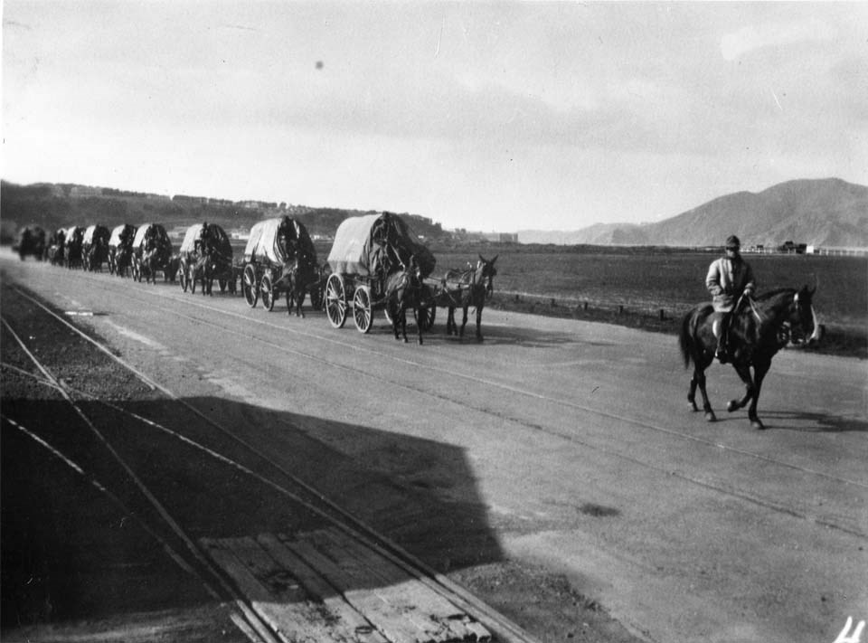 ammunition wagons led by horses on a road