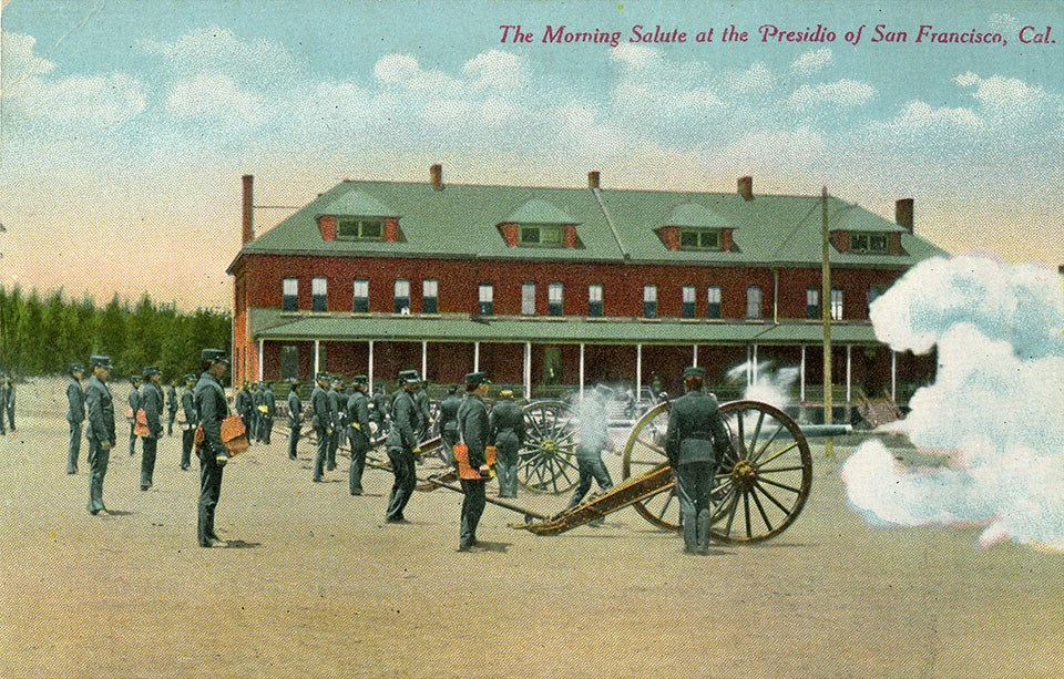Colorized postcard photo of the Parade Grounds with artillery c1900