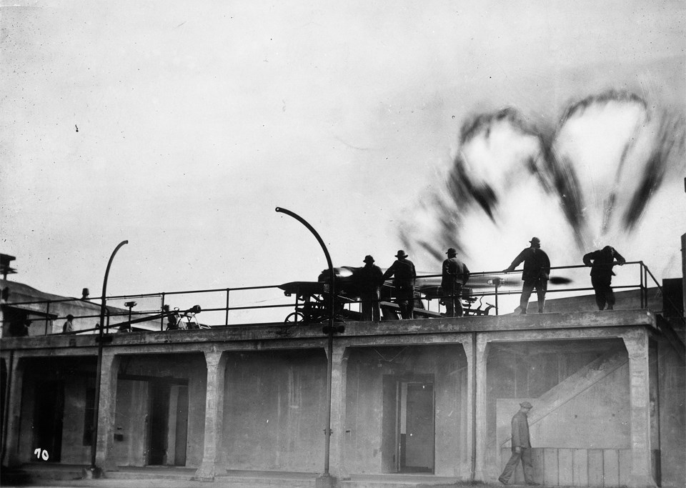 soldiers on railing with smoke