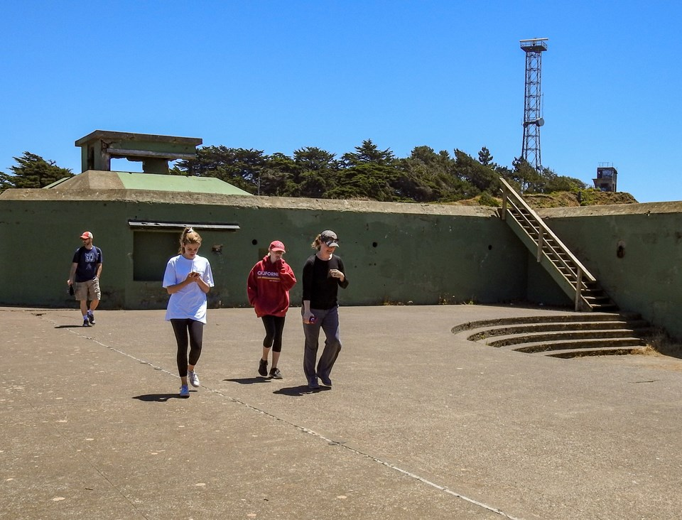 women jogging where the disappearing gun once stood