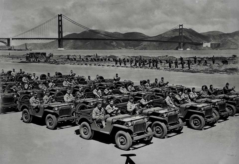 soldiers in trucks with the golden gate bridge in the background