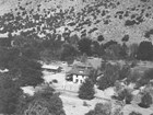 Aerial view of Faraway Ranch buildings at the base of a steep hillside