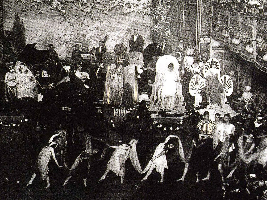Masquerade ball in the 1910s or 1920s at Webster Hall, New York City, New York.