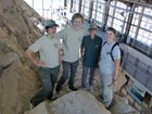 4 interns on large quarry wall in visitor center