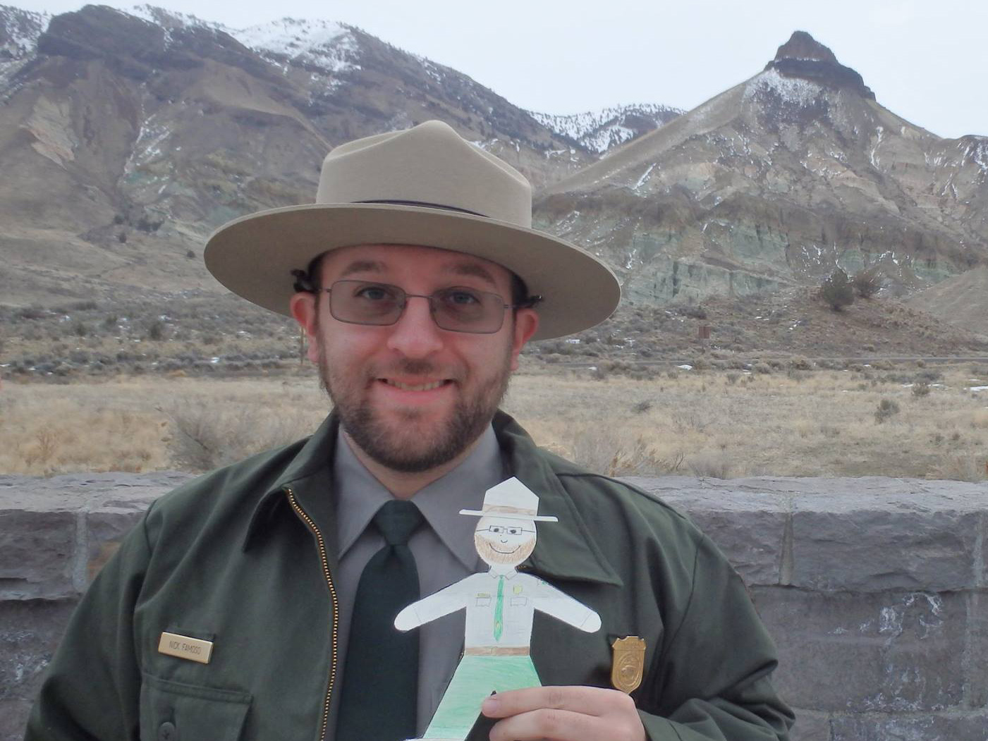 Nick Famoso posing with a Flat Stanley