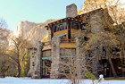 Exterior view of a stone hotel in Yosemite