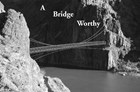 Bridge attached to two rocky cliffs spanning a river, text reads