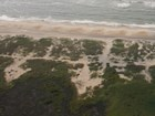 aerial view of sandy coast with evidence of dune breach washover