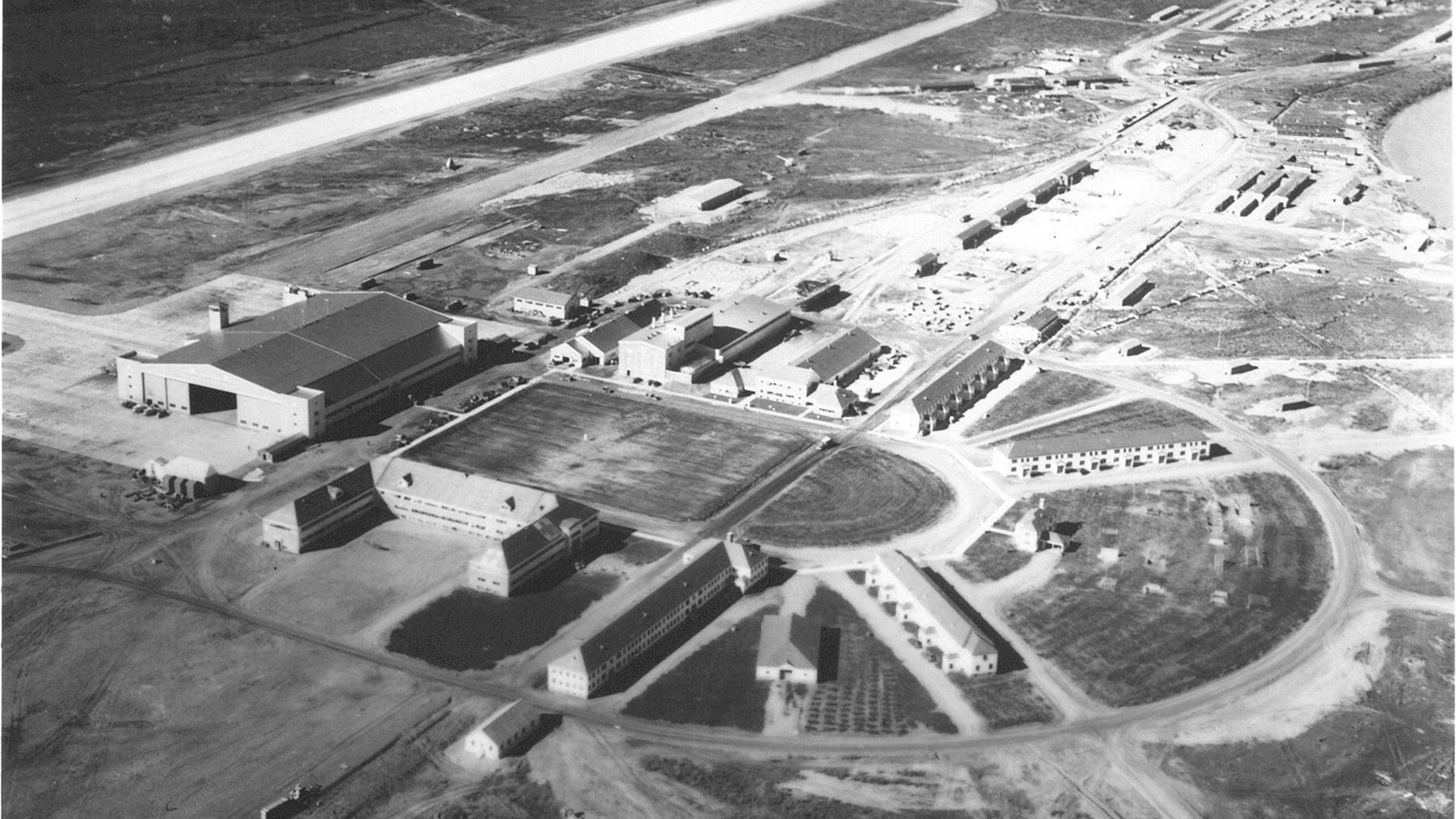 A historic aerial photo of Ladd Field hangars and runways