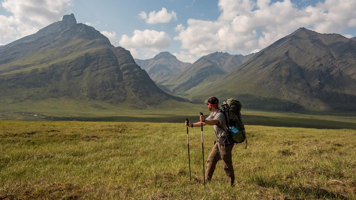 A park ranger backpacking in the mountain wilderness of Gates of the Arctic
