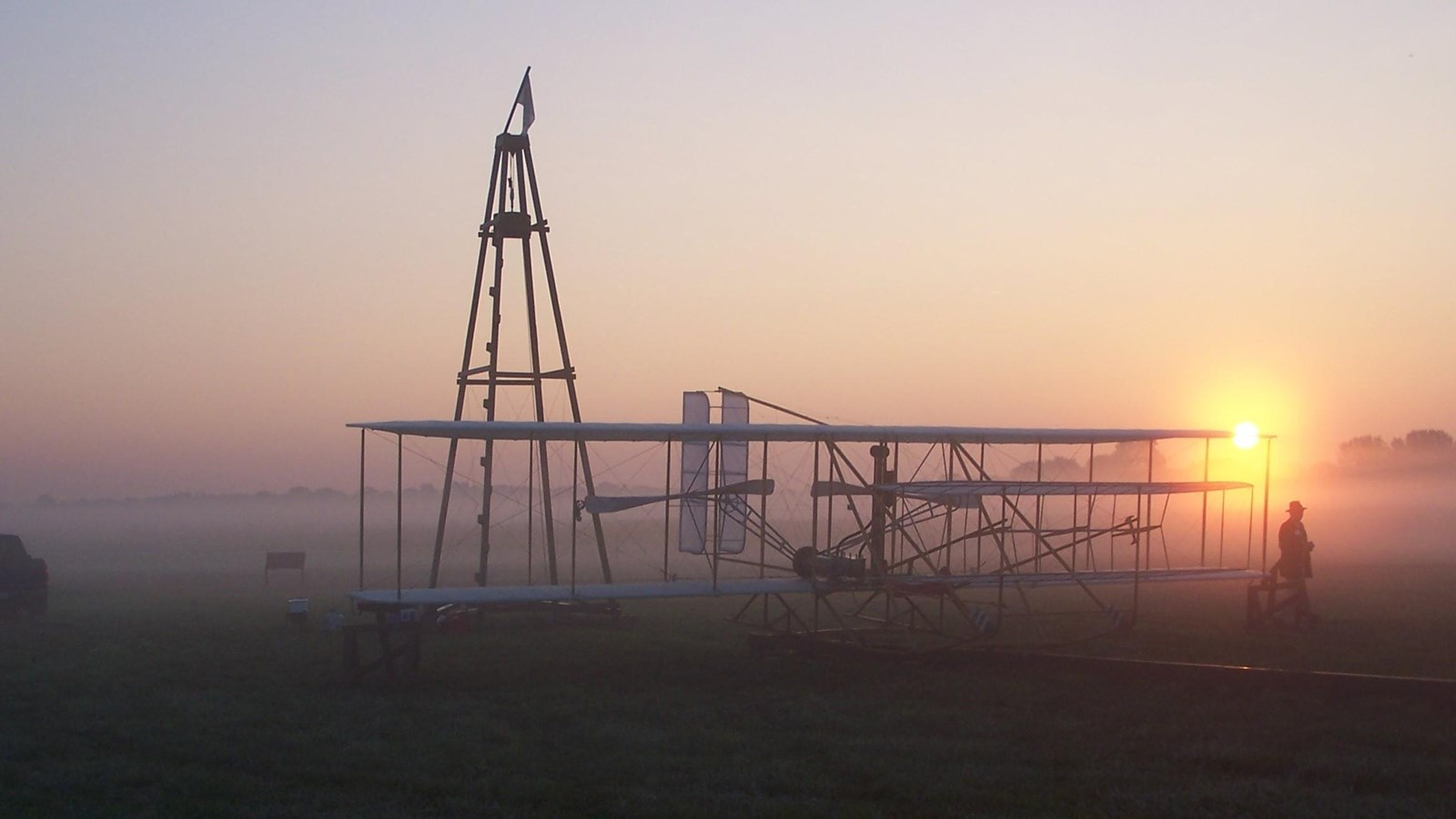 Historic airplane at sunrise  in field