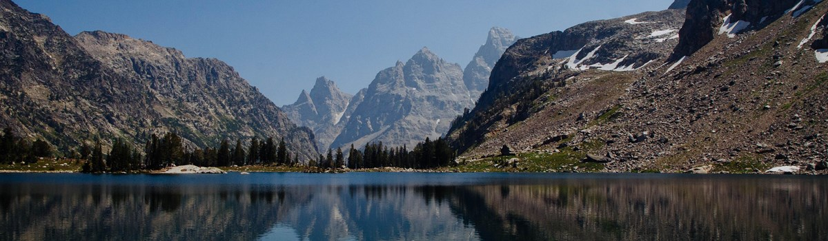 The Grand Teton and Mount Owen reflected on a calm lake.