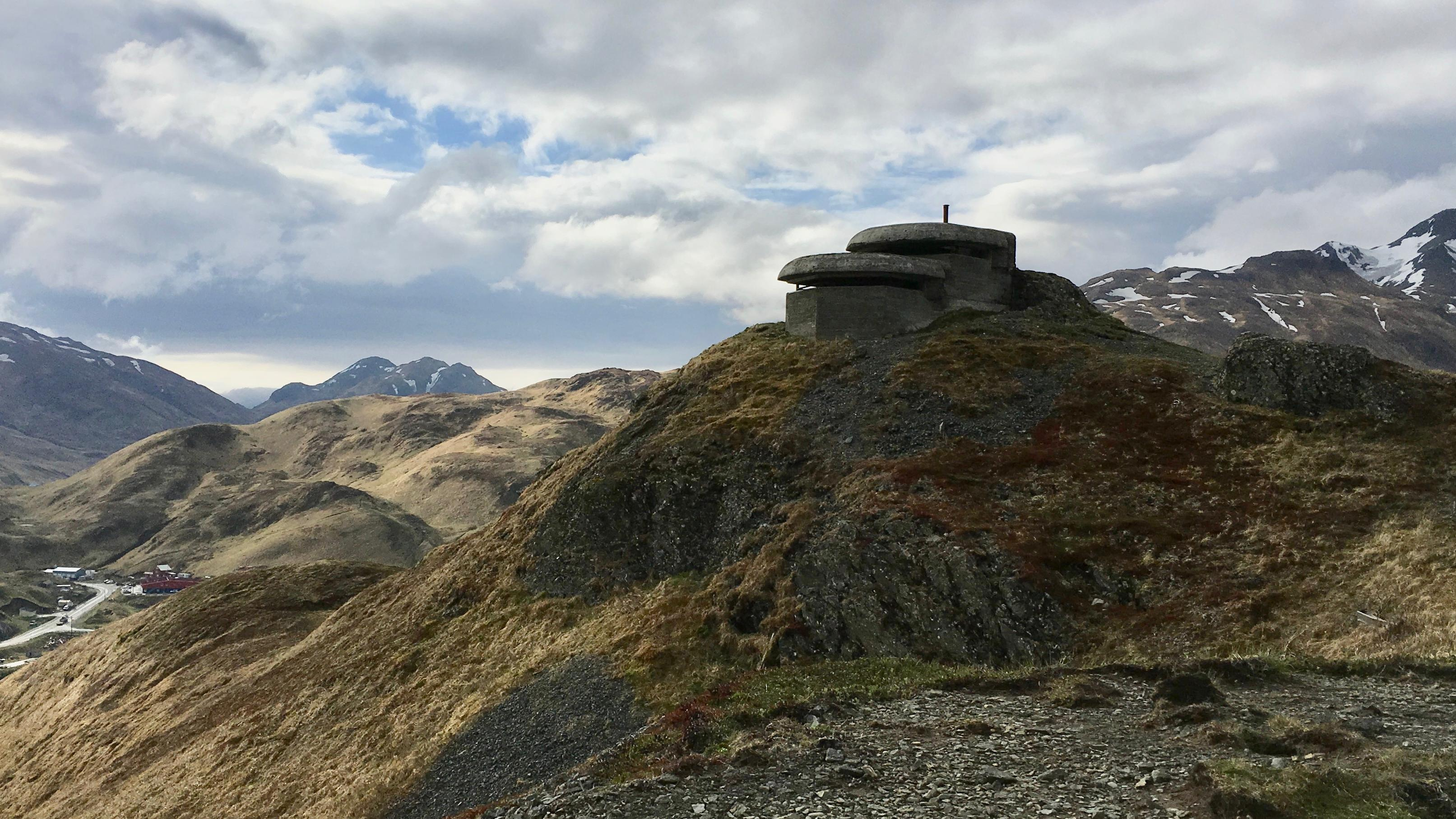A cement WWII lookout on top of a sea cliff on Amaknak Island, Alaska.