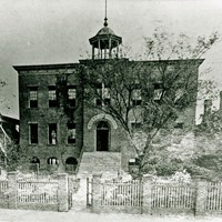 The Avery Normal Institute in 1870, surrounded by picket fence.