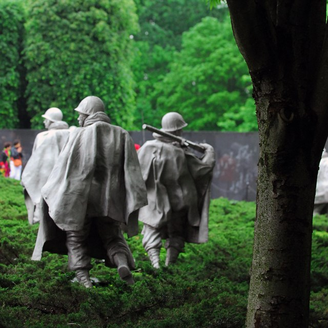 Sculptures of soldiers in the Korean War Veterans Memorial.