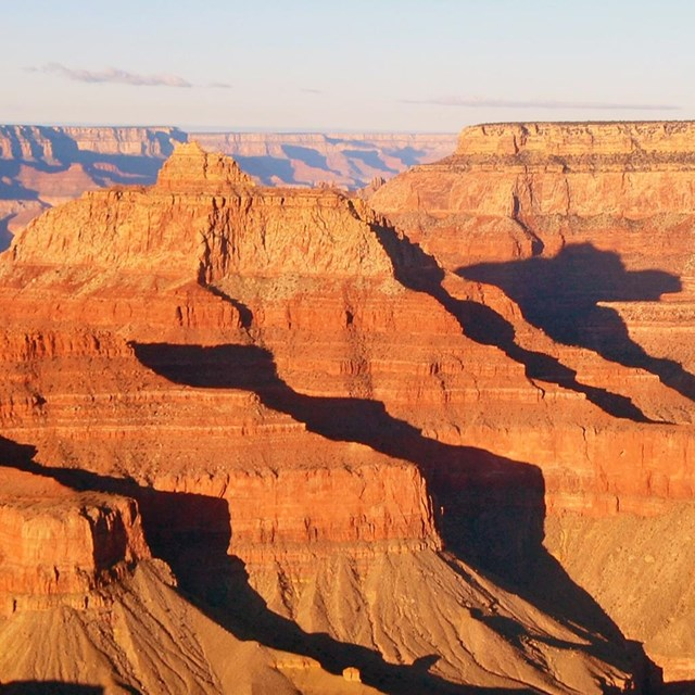 Warm light illuminates the Grand Canyon