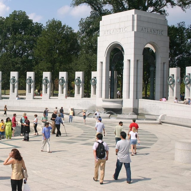 Visitors explore the World War II Memorial on the National Mall in Washington, D.C.