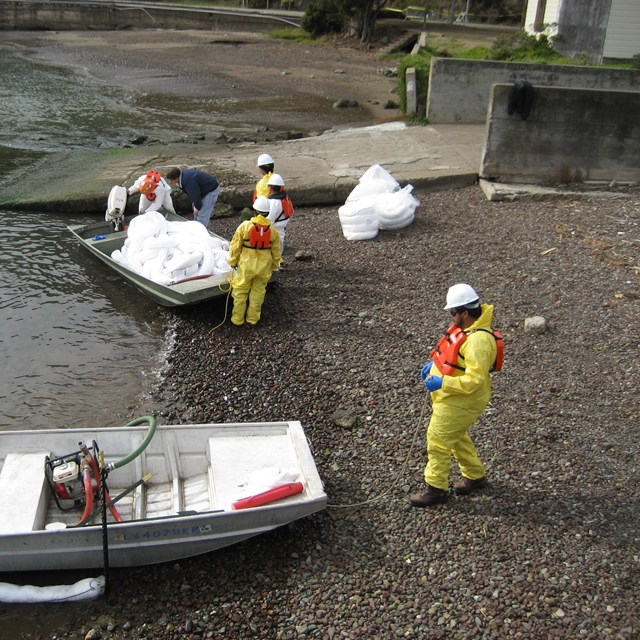 Oil spill response workers gather materials to respond to an event.