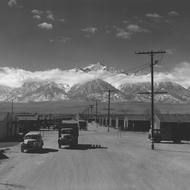 Relocation camp in World War with mountain backdrop