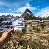 A hand holds historic photo aligned with actual historic hotel building
