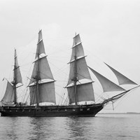 Black and white photo of the USS Constellation sailing on the water