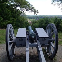 The replica cannon overlooks the town of Morristown from Fort Nonsense.