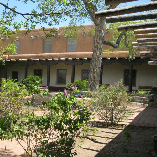 Old Santa Fe Trail building landscape, NPS Regional Office, with adobe structure and courtyard.