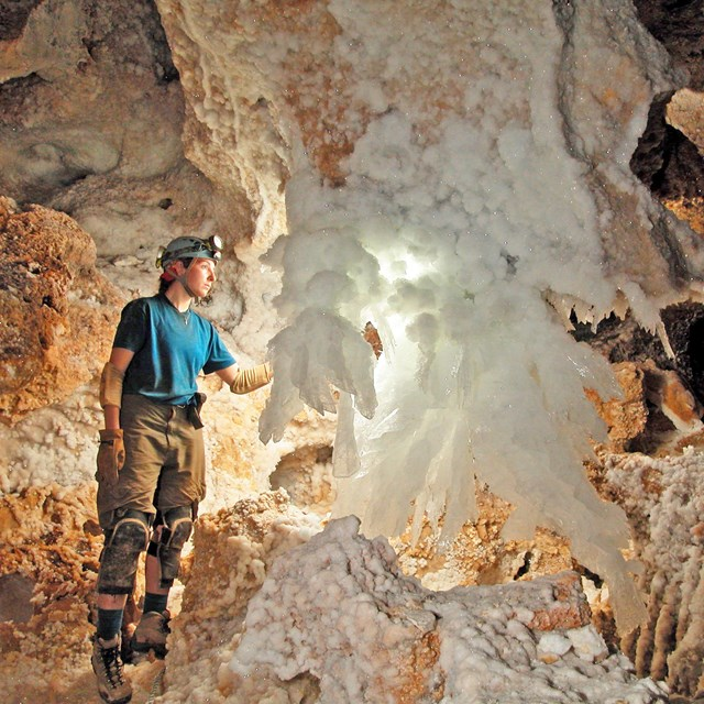 A Caver lights up a gypsum chandelier