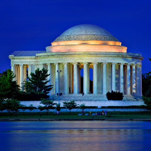 The Thomas Jefferson Memorial illuminated at dusk.