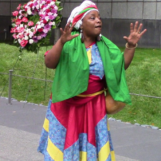 A woman paying tribute to the ancestors at the monument.