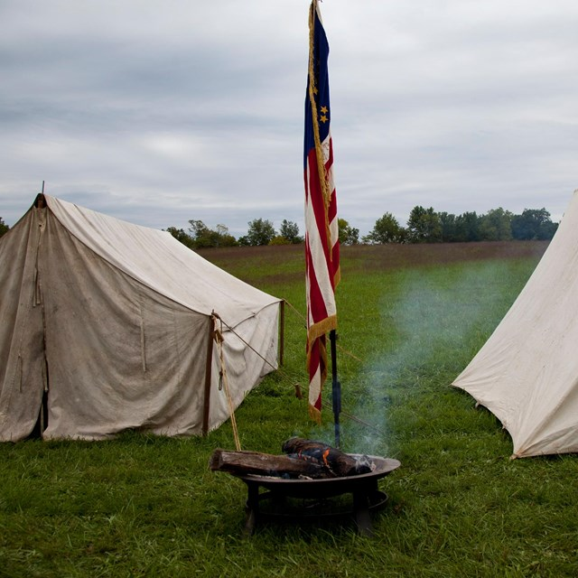 Tents set up on battlefield as part of reenactment.