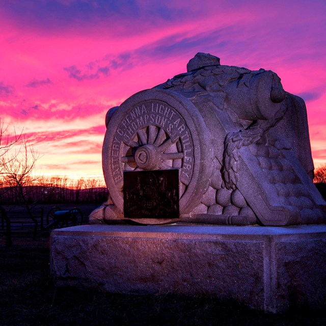 The monument to Pennsylvania Independent Battery C in the Peach Orchard with a brilliant sunset.