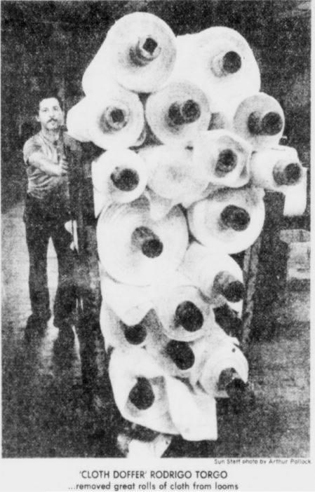 Colombian worker Rodrigo Torgo moves bolts of cloth around the Wannalancit Mill in 1980
