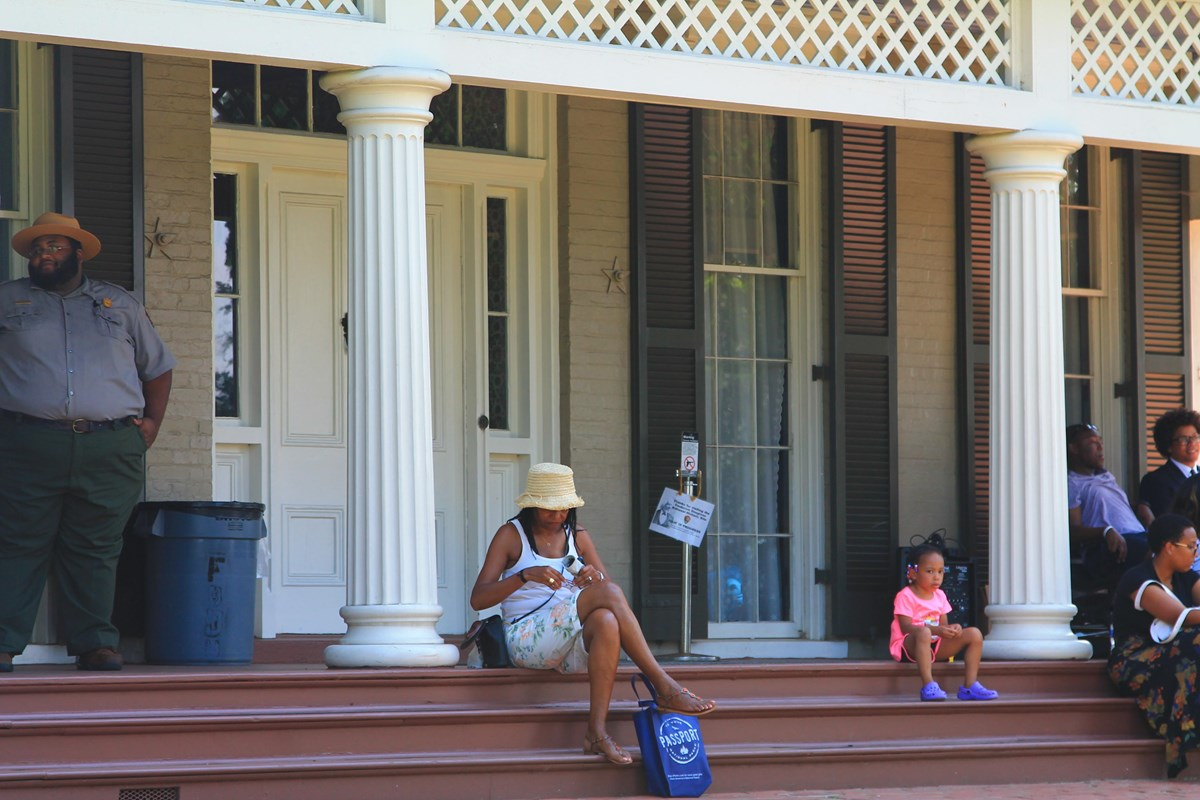 Visitors on the front porch of Douglass's home