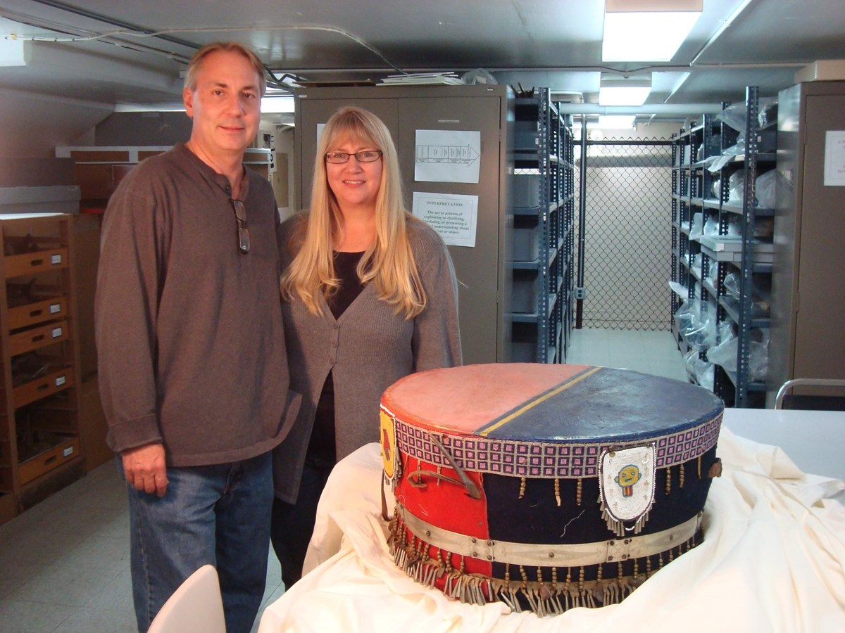 Kelly and Tammy Rundle standing next to a ceremonial drum on a table