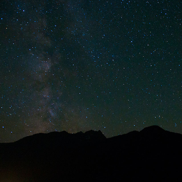 The southern portion of the Milky Way over Castle Rock during the Perseid meteor shower in Stehekin.