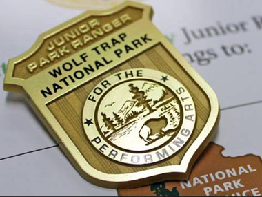 Wolf Trap's Junior Ranger book and badge