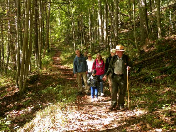 Ranger and visitors on a trail