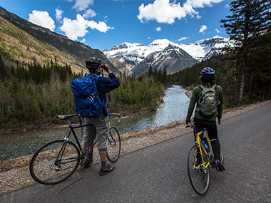 Bikers stop and take in a view of the Garden Wall on the Going-to-the-Sun Road