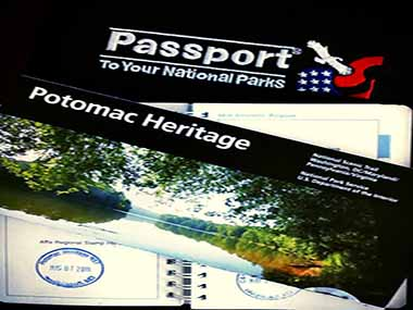 Potomac Heritage map, passport stamp book, and stamps